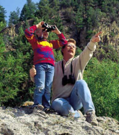 A man and a boy are looking at the scenery