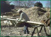 Photo: Man working cutting lumber.
