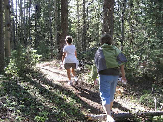 Two people hiking on the Acker Trail