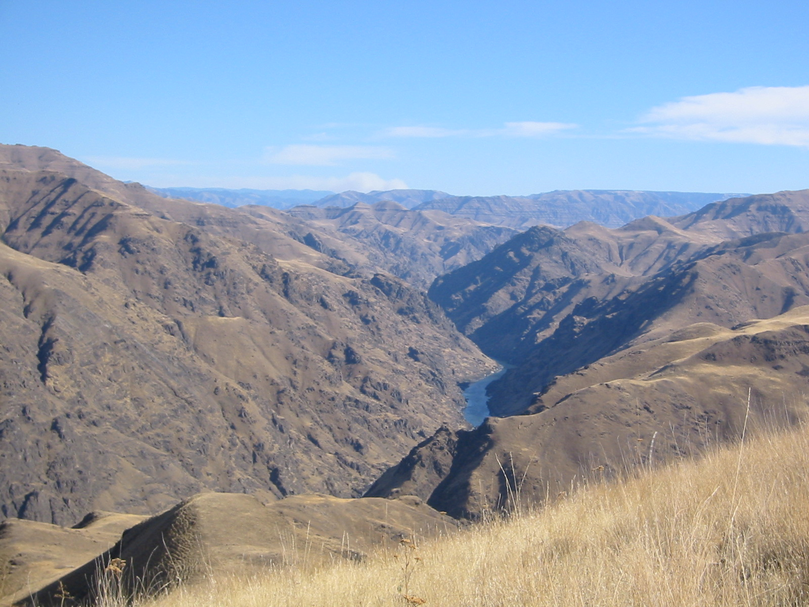 Open grassy ridge with Snake River in background