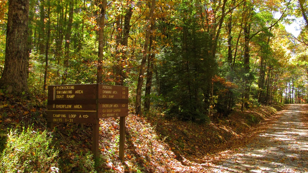 wooden signs along entry road to lake Conasauga showing directions to picnic area