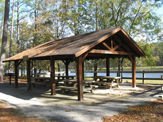 Group picnic shelter on a lake in the forest