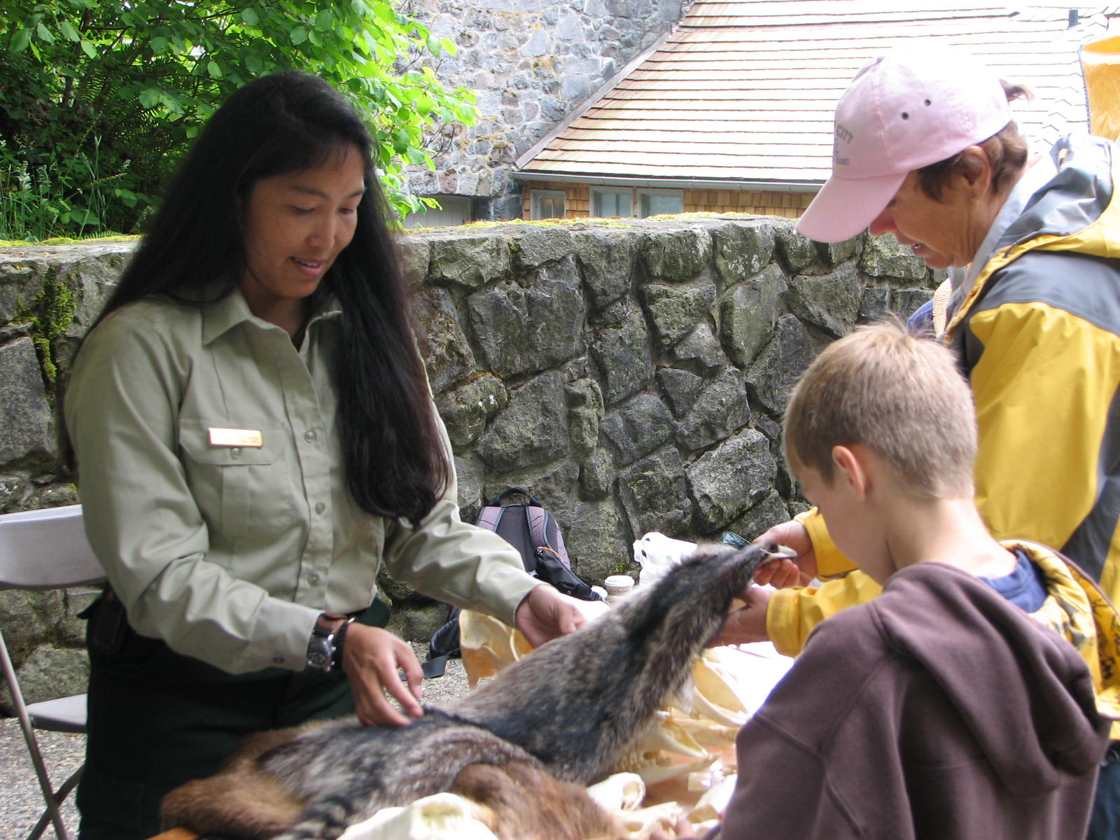 FS employee showing pelts to kids