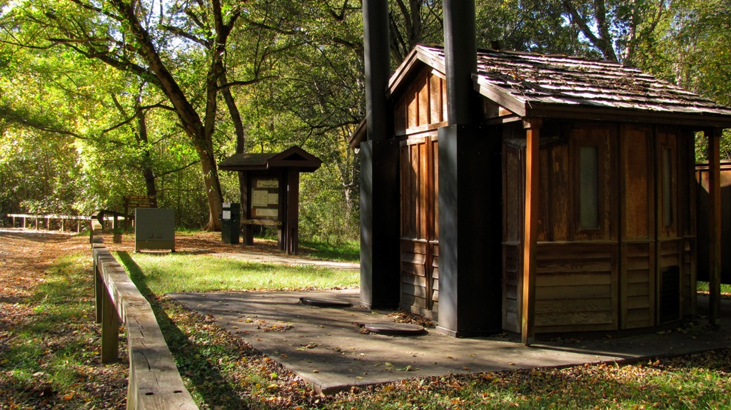 View of campground, newly renovated restroom and kiosk at Cottonwood Patch