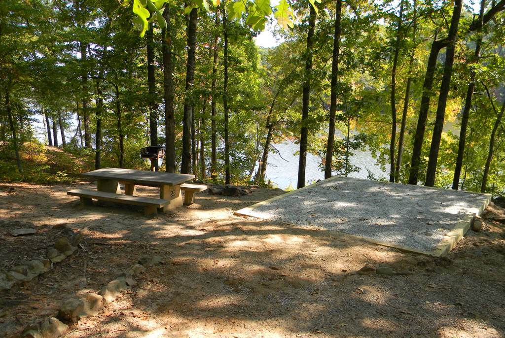 A campsite in dappled sun overlooking Lake Sinclair