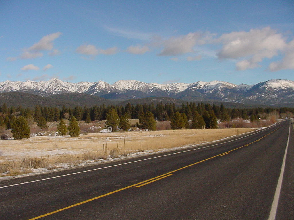 Juorney Through Time Scenic Byway with snow capped Elkhorns peaks in background