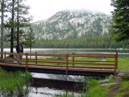 Trail bridge around Anthony Lake with mountain peak in background