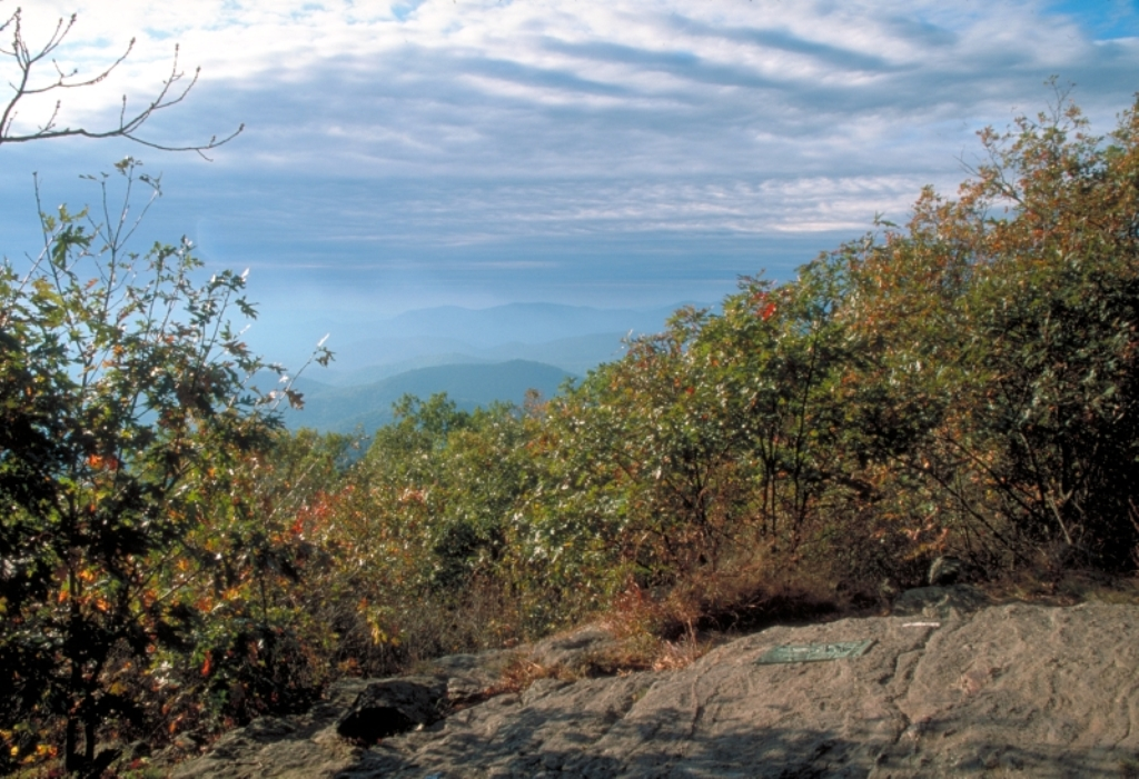 The AT plaque can be seen on the rock outcrop below a panoramic view of the Blue Ridge Mountains