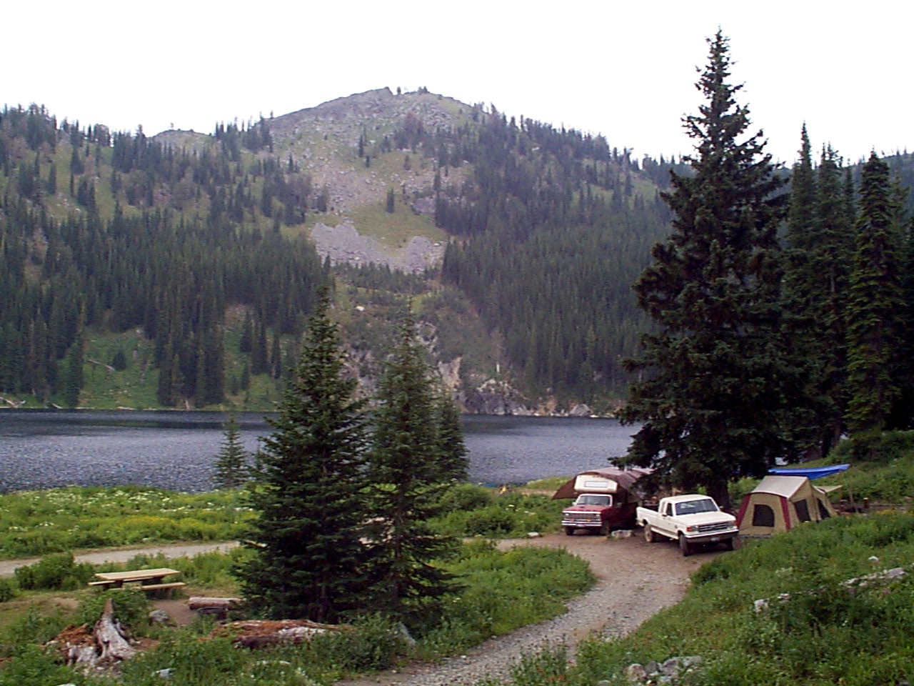 High mountain lake and campers at Black Lake Campground