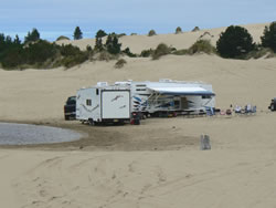 OHV Sand Camping with RV in dunes area showing dispersed setting and no facilities