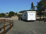 Photo of trailer using paved access to sand area at Bark Road Staging Area