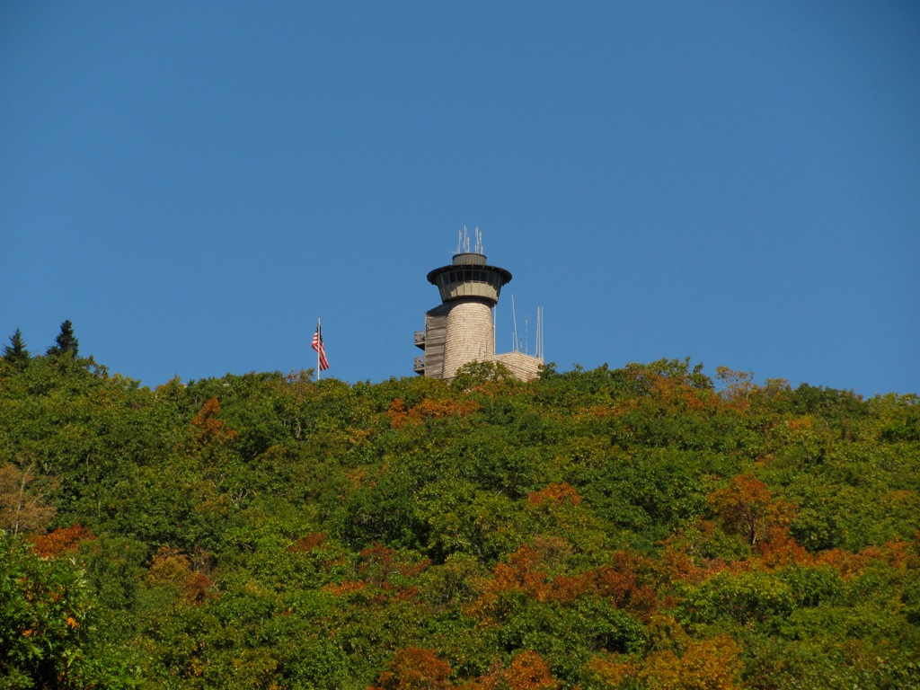Brasstown bald visitor center and firetower can be seen in the distance surrounded by fall foliage