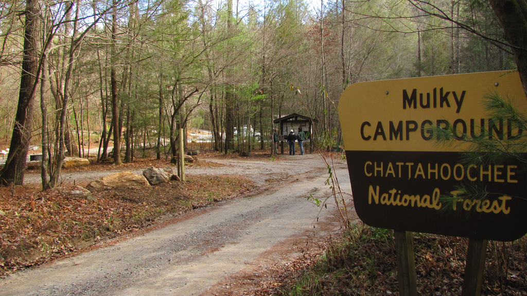 Mulky Campground portal sign stands proudly with view of campsites & information board in background