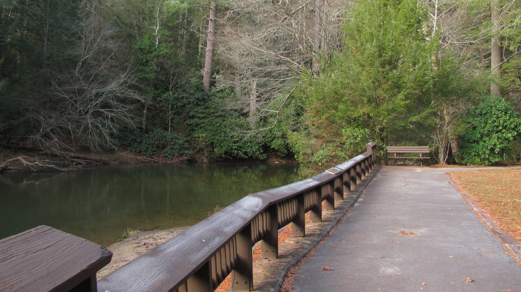 View of the wooden Toccoa River overlook and fishing platform at Deep Hole Campground