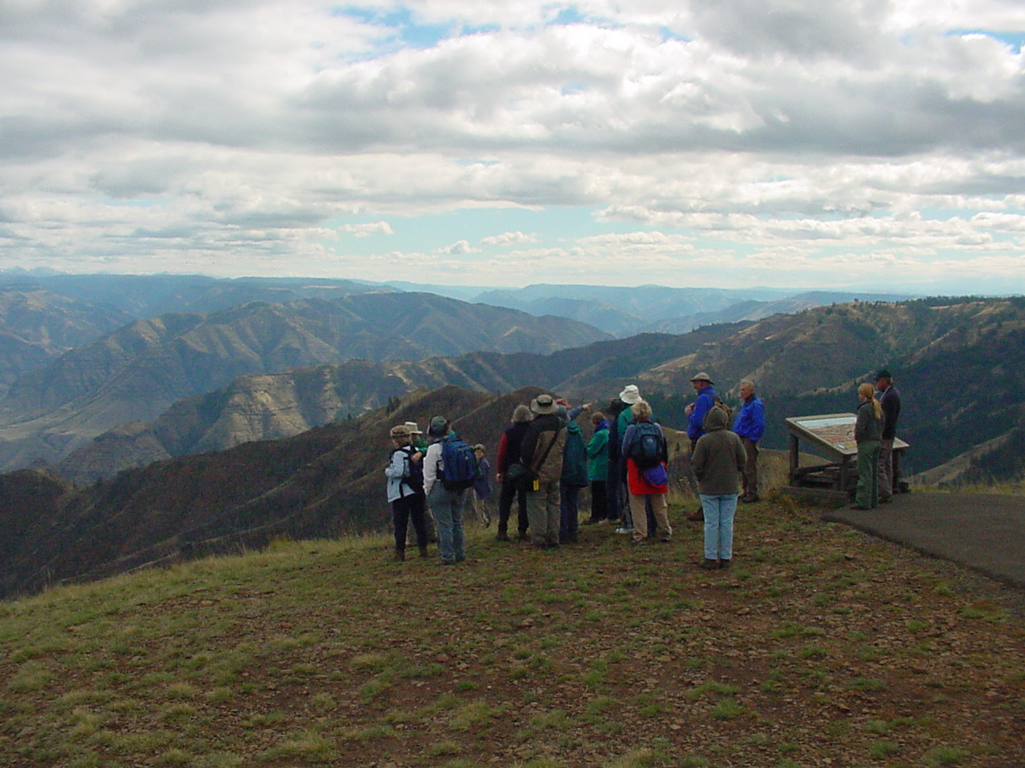 Large group overlooking open canyon and grassy slopes