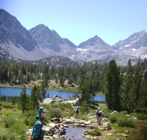 Hikers enjoy the spectacular scenery of Little Lakes Valley.