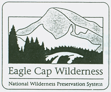 Eagle Cap Wilderness logo with outline of a mountian
