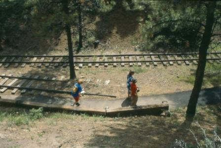 View of visitors walking on reconstructed railway tracks