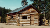 Elwood Cabin, in the Rio Grande National Forest, located in south-central Colorado along the New Mexico border, and link to the Facility Details page at Recreation.gov