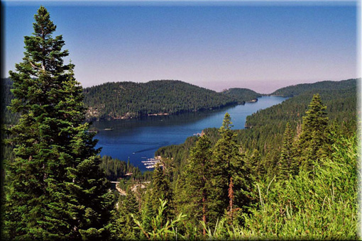 Vista of deep blue lake in a forested area