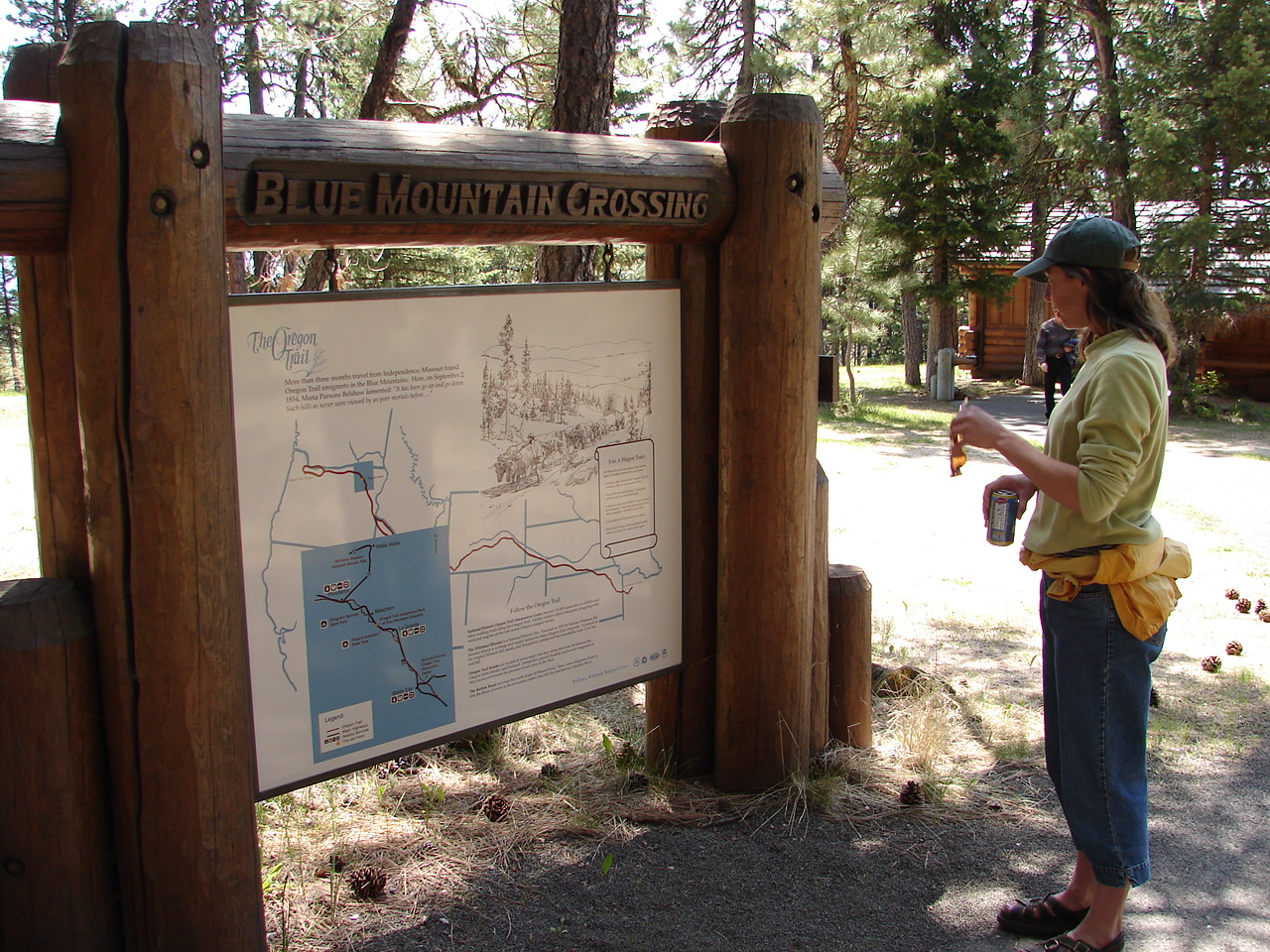 Hiker reading an interpretive sign at Oregon Trail Interpretive Park