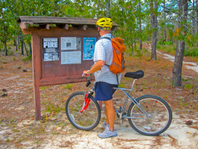 Bicyclist at Paisley Woods kiosk