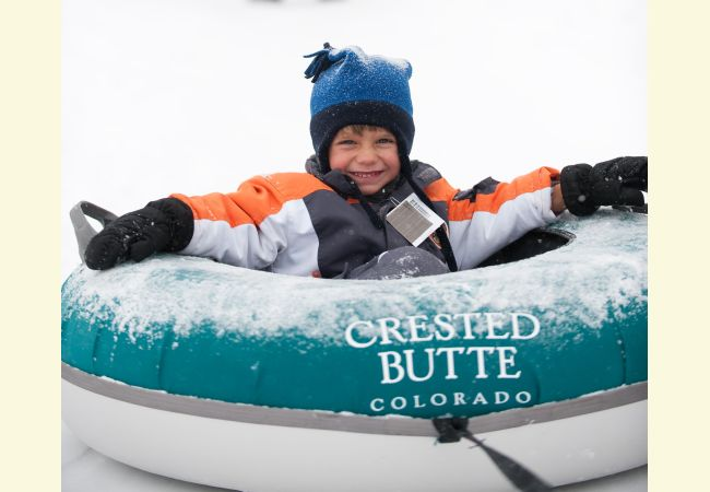 child in tube at Crested Butte