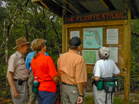 Hikers at the Eaton Creek trailhead kiosk