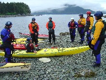 A group of kayakers gives a safety talk before setting out.