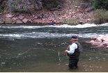 Photo of a man fly fishing on the Green River.