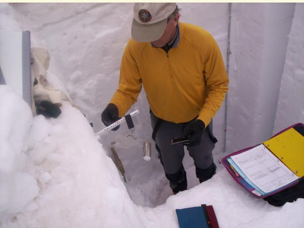 iamges of man in snow pit taking snow samples