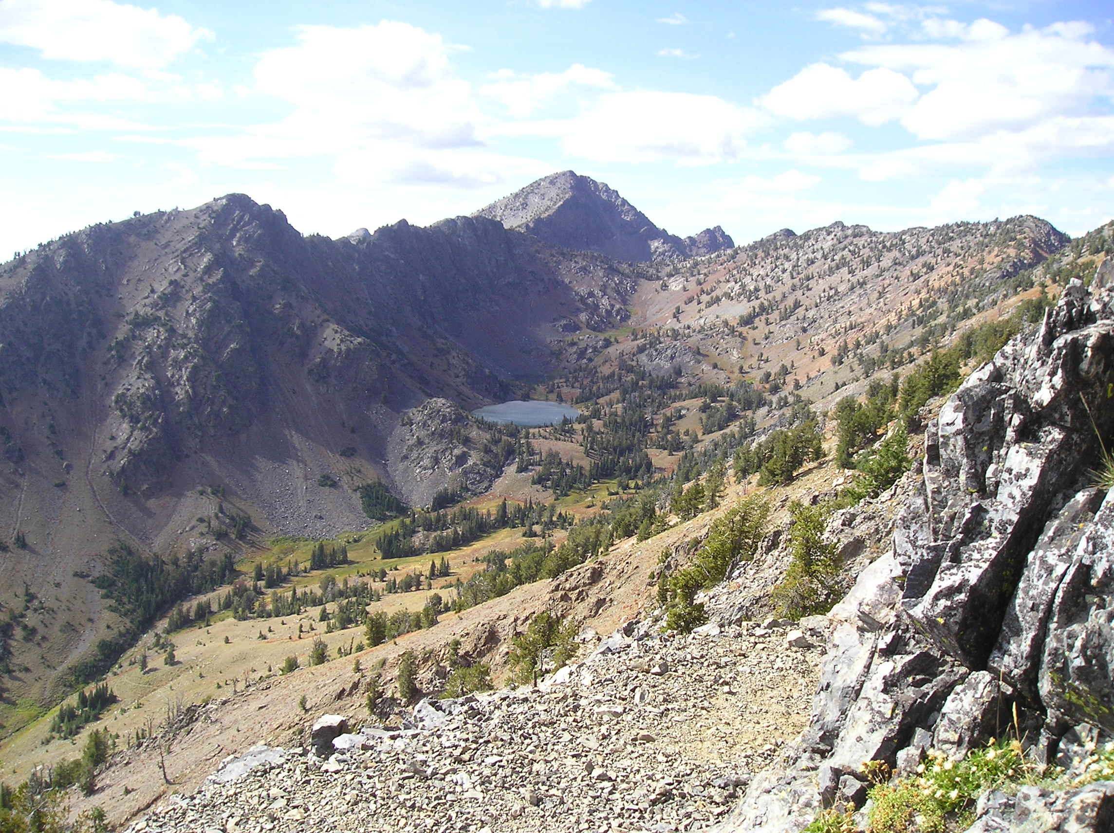 HIgh mountain Twin Lakes in distance along rugged trail