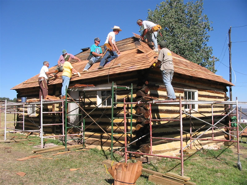 2005 PIT volunteers re-shingling the two-room cabin.