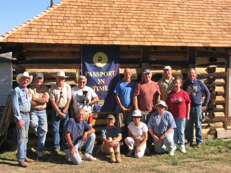 2005 PIT volunteers in front of the re-shingled two-room cabin.