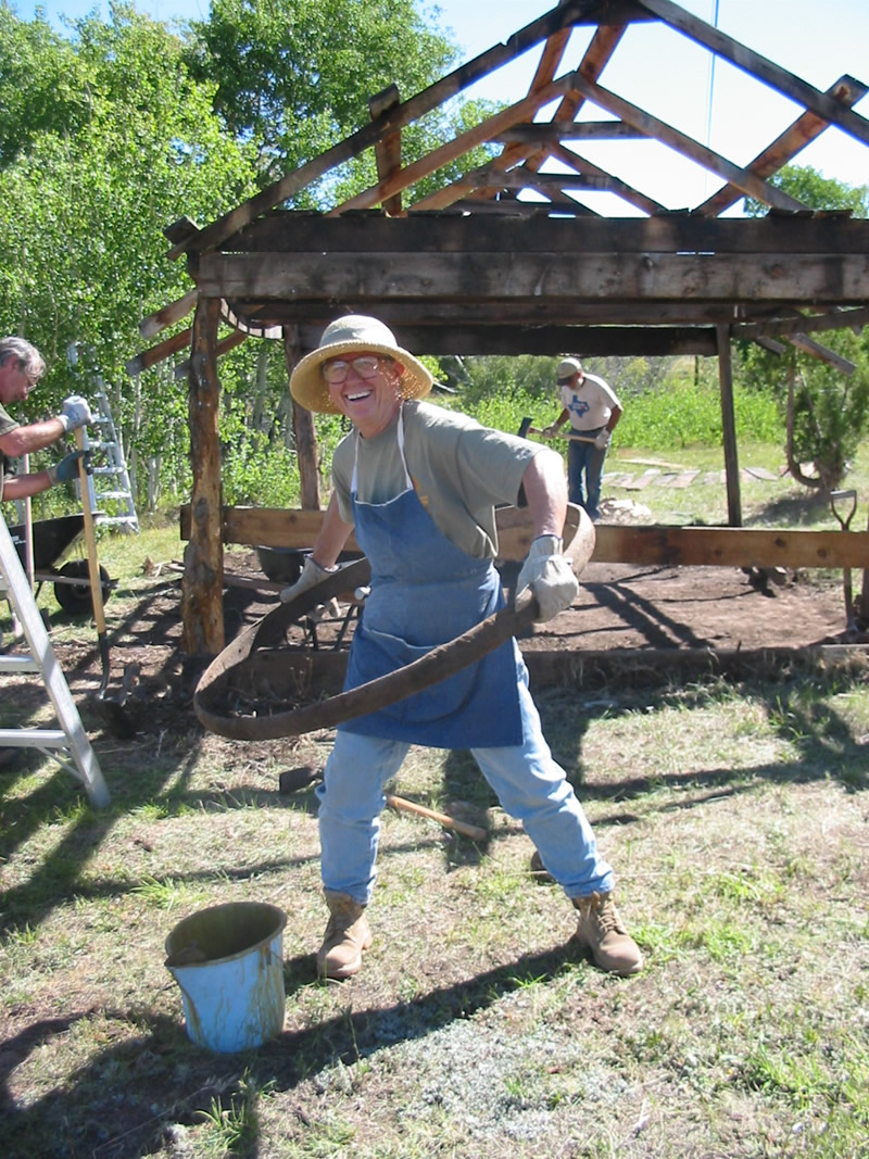 Ginger Schlote having some fun while working on the first blacksmith shop (2004).