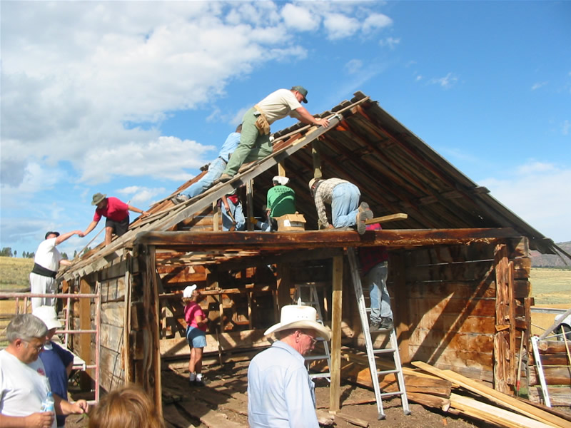 2003 PIT volunteers replacing the roof on the milking barn.