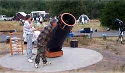 Large telescope  with some kids near it
