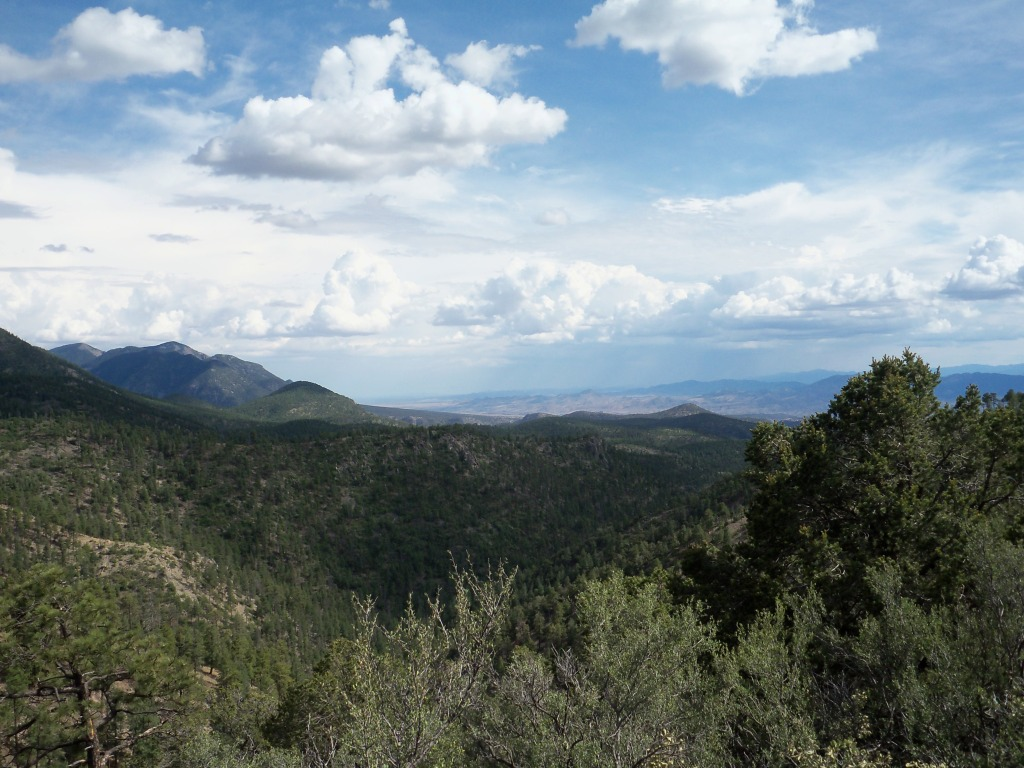 Overlook from trail 90 as summer monsoon builds over the San Mateo Mountains.