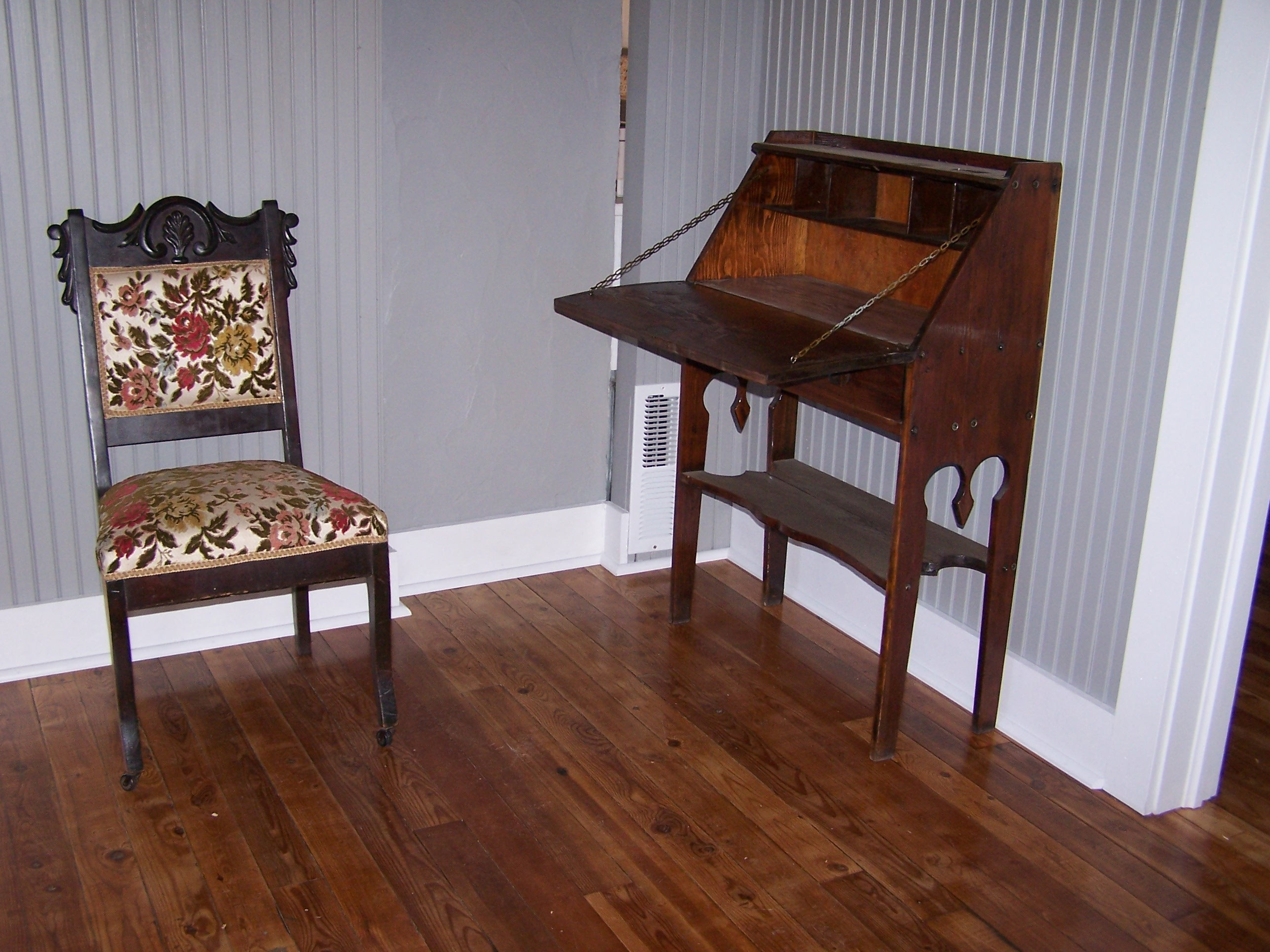 View of the writing desk and chair in the living room