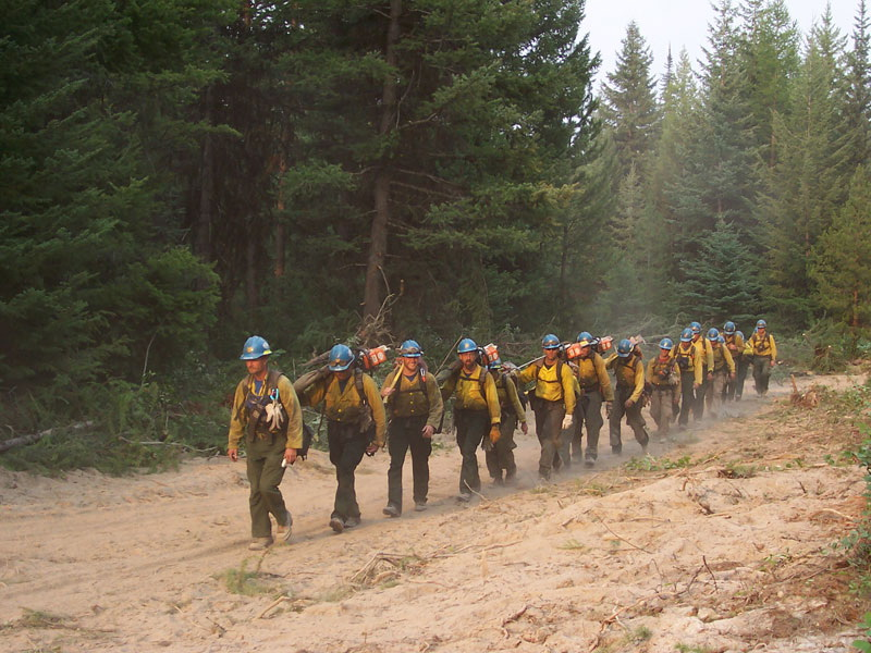 Winema Hotshots on duty walking in a line formation