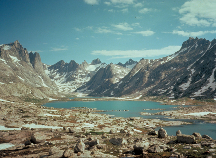 Photo of granite peaks and lake in the Bridger-Wilderness. Photo by Steve Boutcher