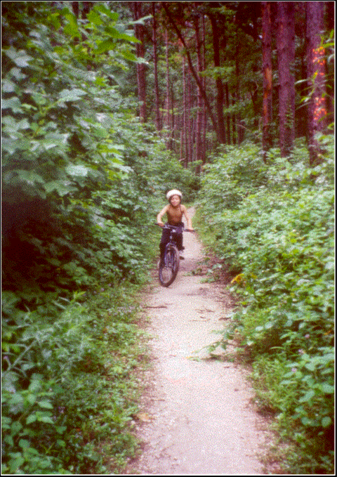 Boy riding a bike on Hickory Ridge Trail