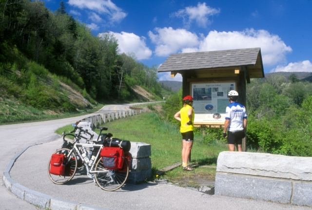 Bicyclists stopping to look at a sign along the Cherohala Skyway