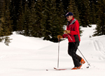 Ski patrol instructor Dick Willy skis to the next learning station.