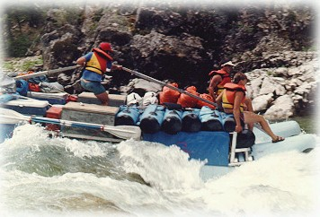 Photo of a group of people white water rafting down the Middle Fork of the Salmon River.