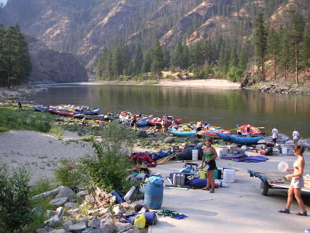 Photo of Corn Creek during a busy time.  There are many boats, supplies and people.