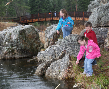 Kids playing next to a lake in the Black Hills National Forest, located in western South Dakota