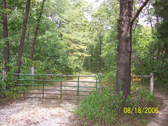 view of the road gate for Cedar Creek Trail at Oak Chapel
