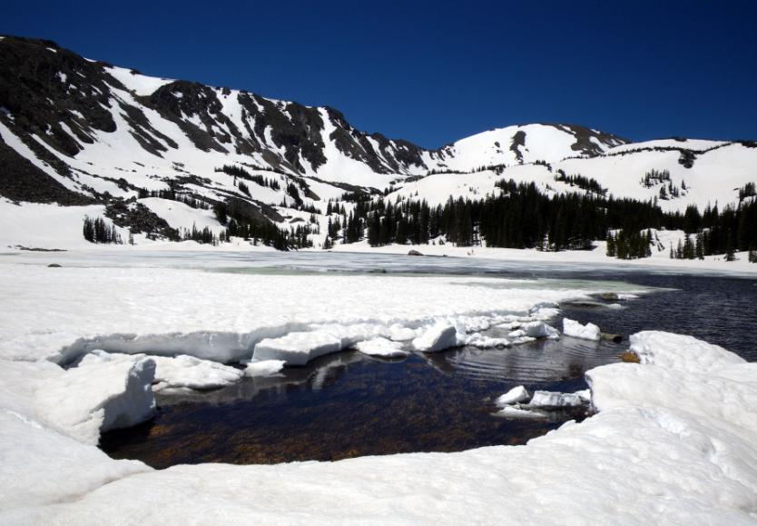 Photo of Diamond Lake in June frozen and covered with snow