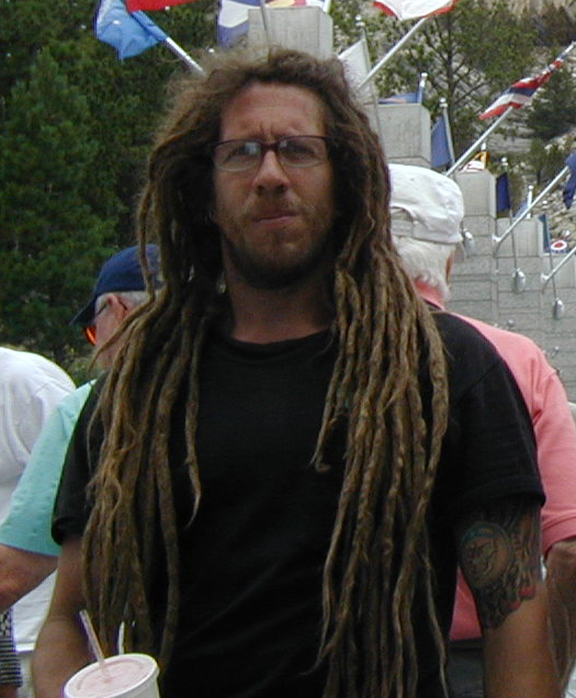 Photo of firefighter with long dreads